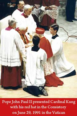 Pope John Paul II presented Cardinal Kung with his red hat in the Consistory